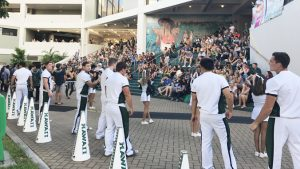 U H cheer squad in front of crowd at Campus Center