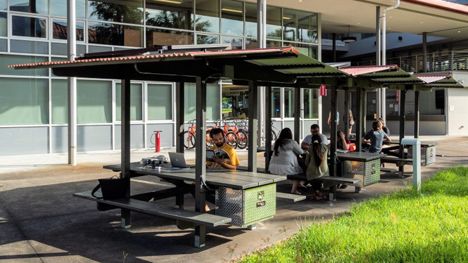 students sitting at charging stations