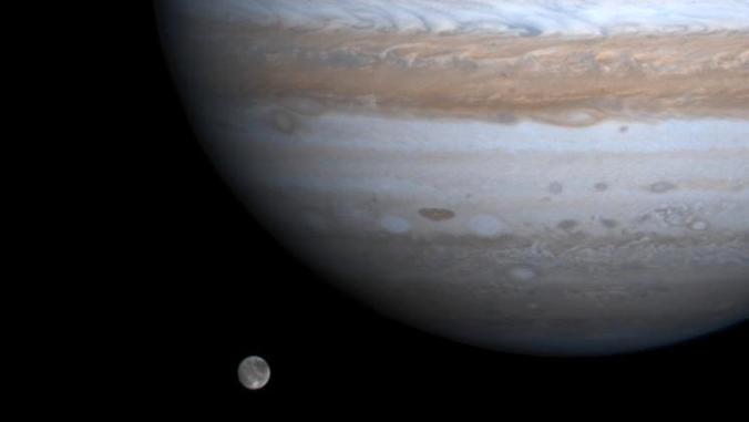 Illustration of Jupiter's moon next to Jupiter