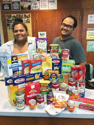 two people with food donations