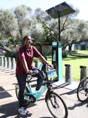 student on a Biki bicycle
