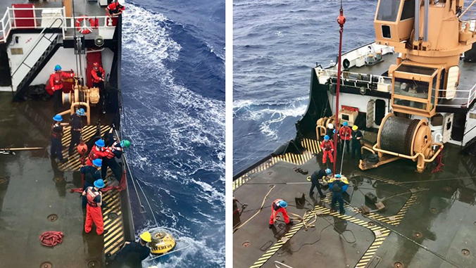 The coast guard crew working to recover the wave buoy onboard the ship.