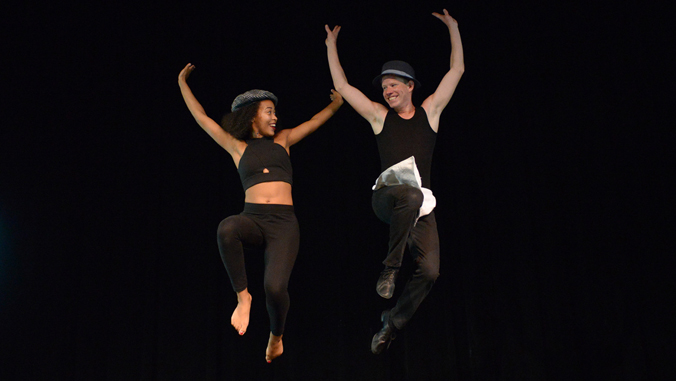 two dancers jumping