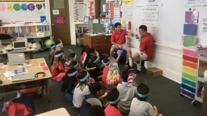 hilo students reading dr. seuss to elementary students