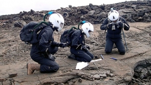 Researcher in space suits taking samples