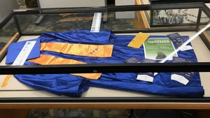 Kapiolani c c cap and gown in a case, click for larger image