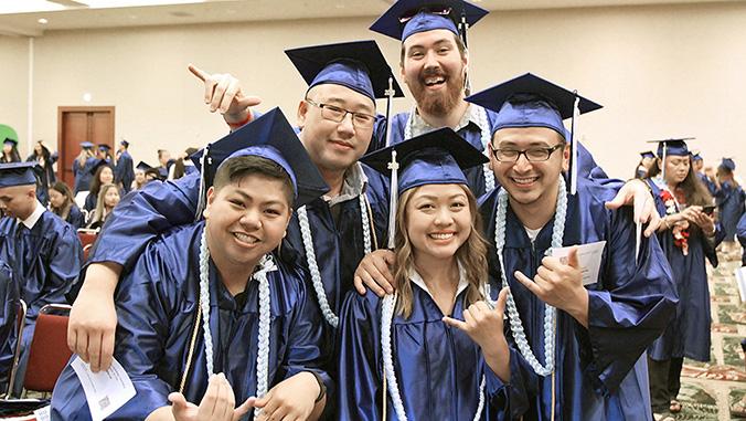 Kapiolani c c graduates in caps and gowns