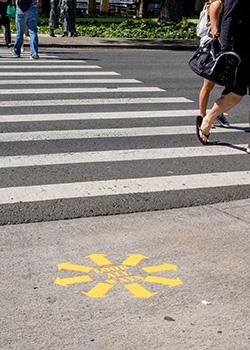 Look All Ways symbol on the sidewalk