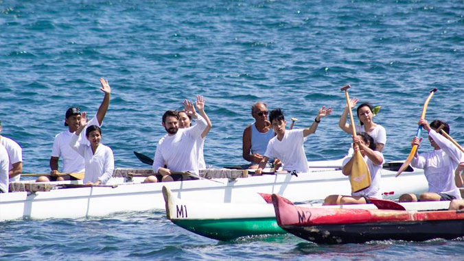 medical students waiving from canoes