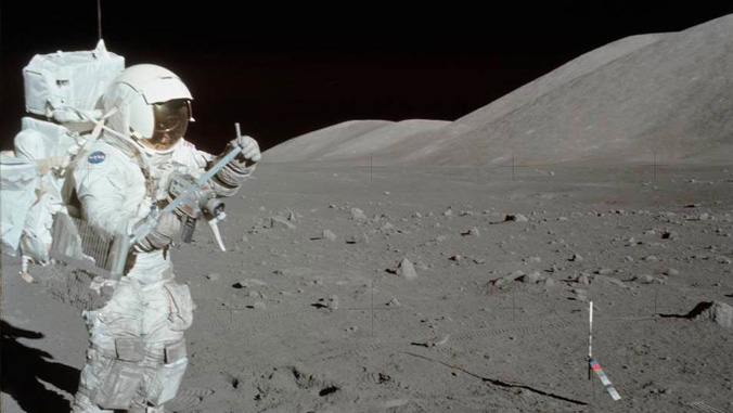 Astronaut walking on the moon taking lunar samples.