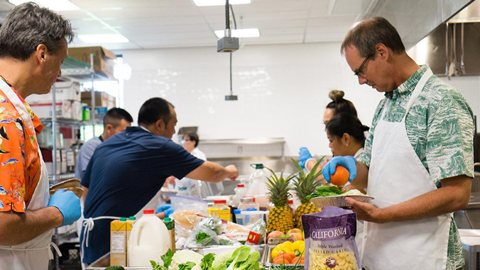 people making food in a kitchen