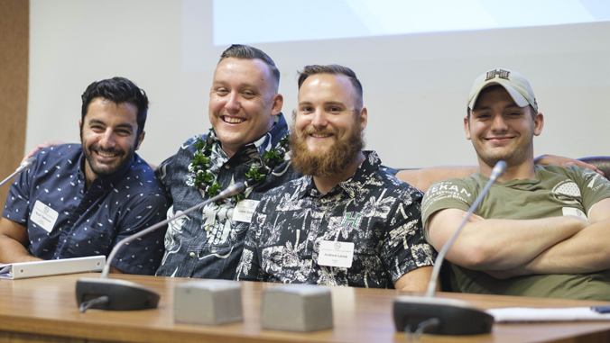 four guys smiling
