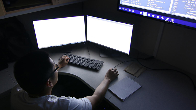 person sitting at a computer