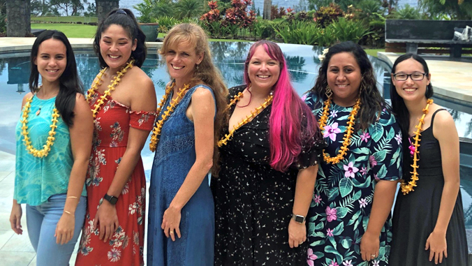 six women wearing lei