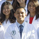 Record size medical class receives white coats