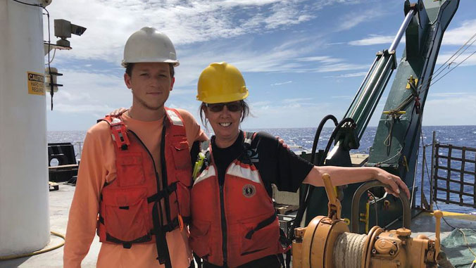Two people aboard the Kilo Moana