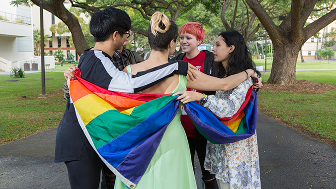 students with gay pride flag