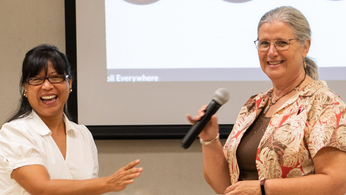 Chancellor Rachel Solemsaas and Chancellor Bonnie Irwin sharing microphone