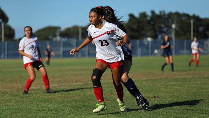 U H Hilo soccer player Lillie on soccer field