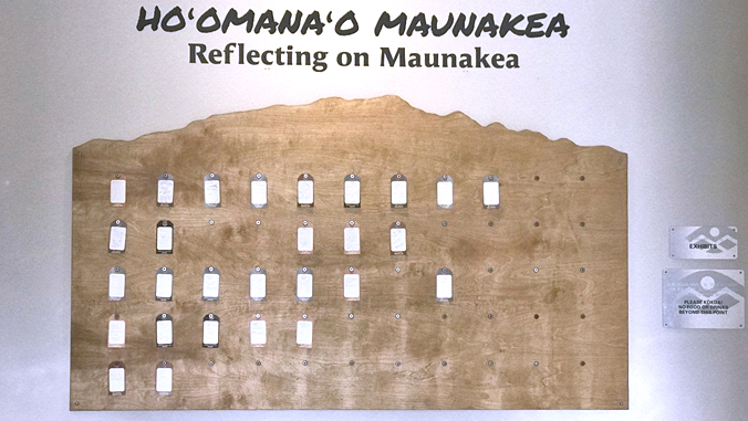 """Exhibit with area for people to post notes with """"Hoomanao Mauankea, Reflecting on Maunakea"""""""