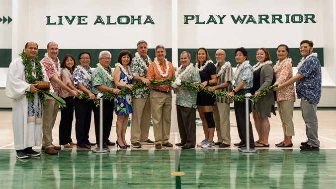 people holding maile lei