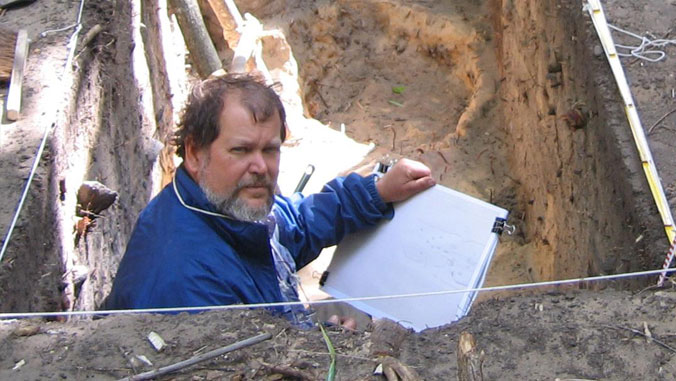 archeologist doing research
