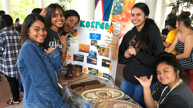 students in front an informational display
