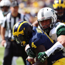 Michigan paying record $1.9M to host Rainbow Warrior football team