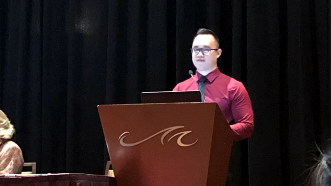 Michael Wong at lecture podium