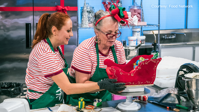 female bakers with christmas themed cake