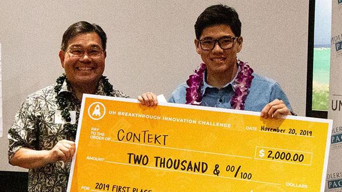 men holding giant check