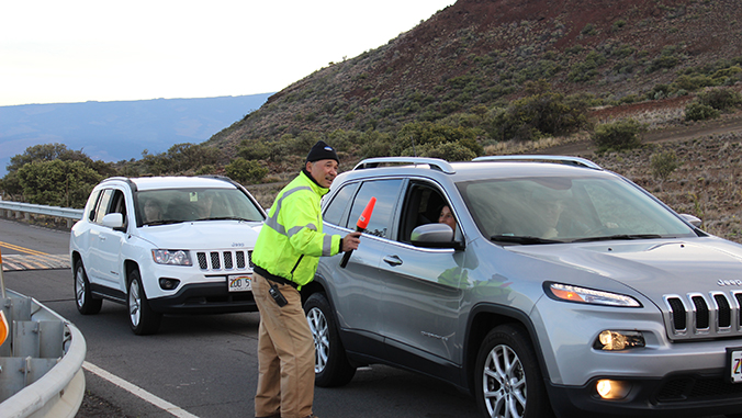 Ranger directing traffic on Maunakea