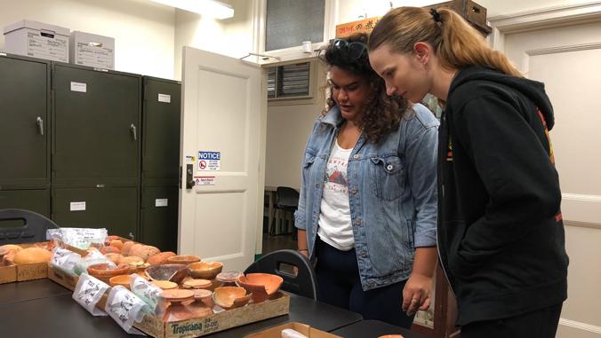 Two graduate students visit exhibit