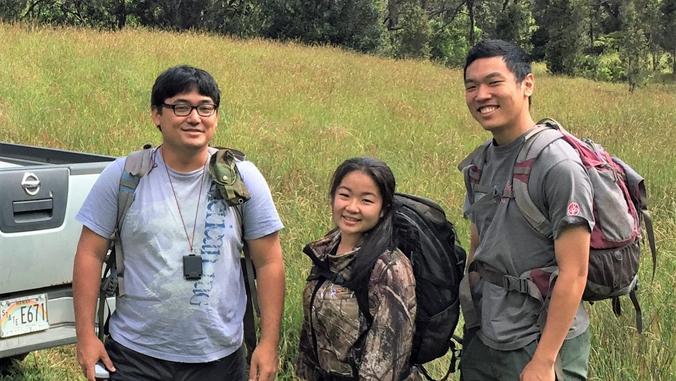 three people in Hawaii Island forest