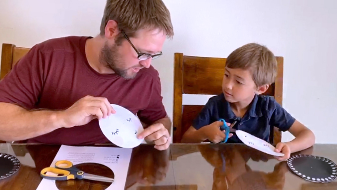 father and son working on a science project