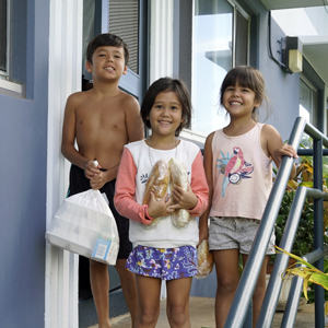 three children holding food containers