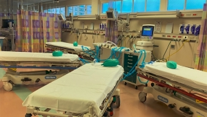 four hospital beds hooked up to one ventilator