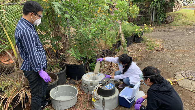 three people doing wastewater sampling research