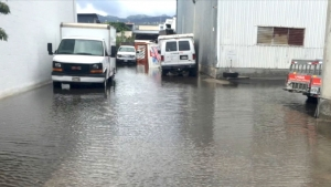 vehicles parked in flooded area