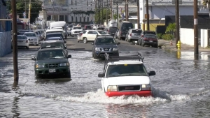 cars driving through flooded area