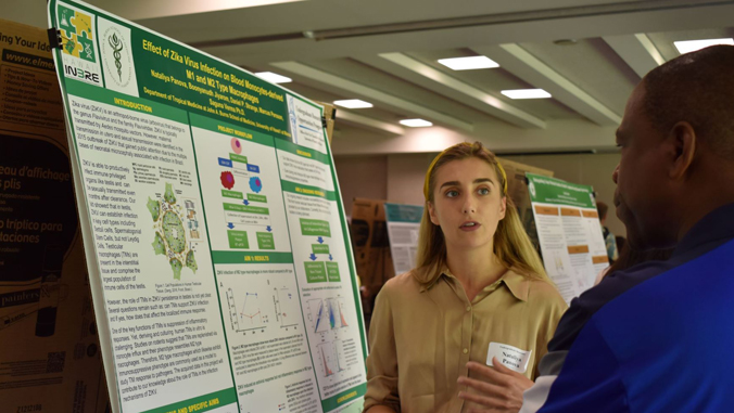 student presents poster