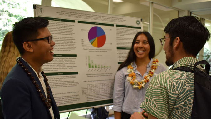 students presenting poster
