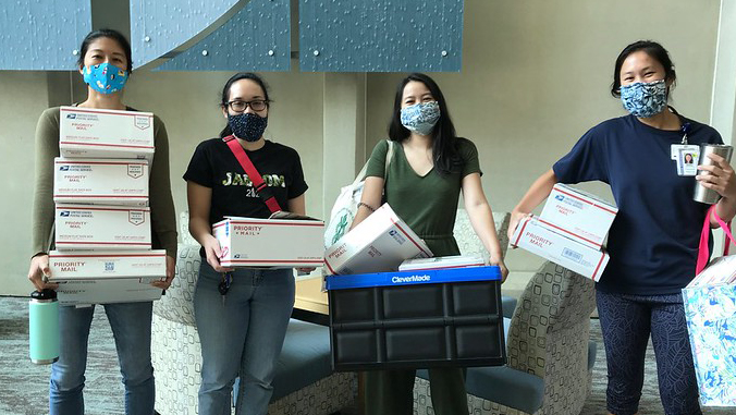 students wearing masks with care packages