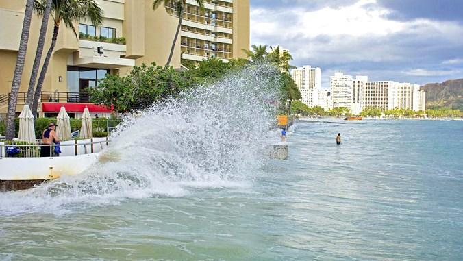 Wave splashing against wall in Waikiki
