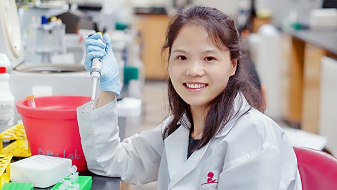 Yanghua He holding syringe