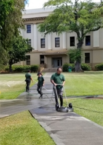 Facilities crew cleaning sidewalks
