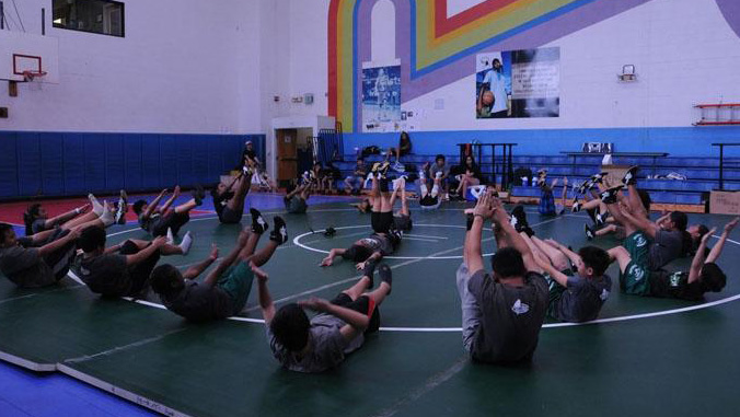 youth in a gym exercising