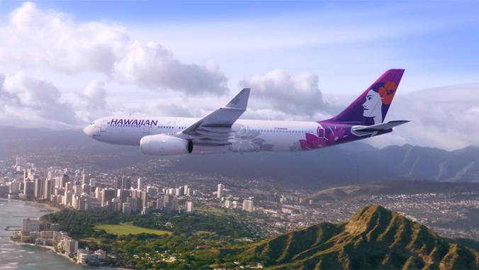 Hawaiian Airlines plane over Diamond Head