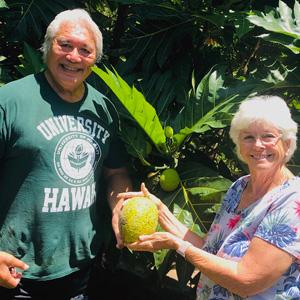 Avegalio and Kelly holding breadfruit