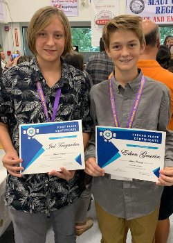 Two boys with awards